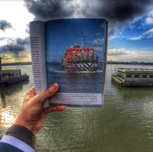 Liverpool's Dazzle Ferry shown in a book against real life