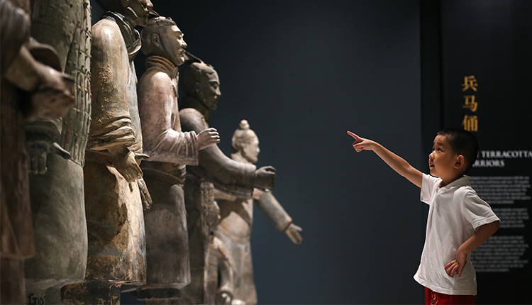 Young boy points at Terracotta Warriors