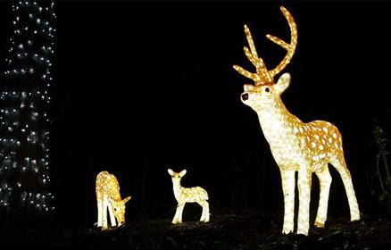 A light-up deer and two deer babies