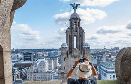 Taking a picture at the top of the Royal Liver Building