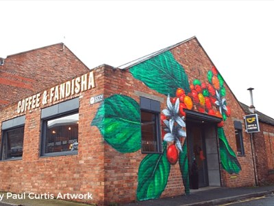 Coffee and Fandisha Exterior showing colourful artwork of a coffee plant