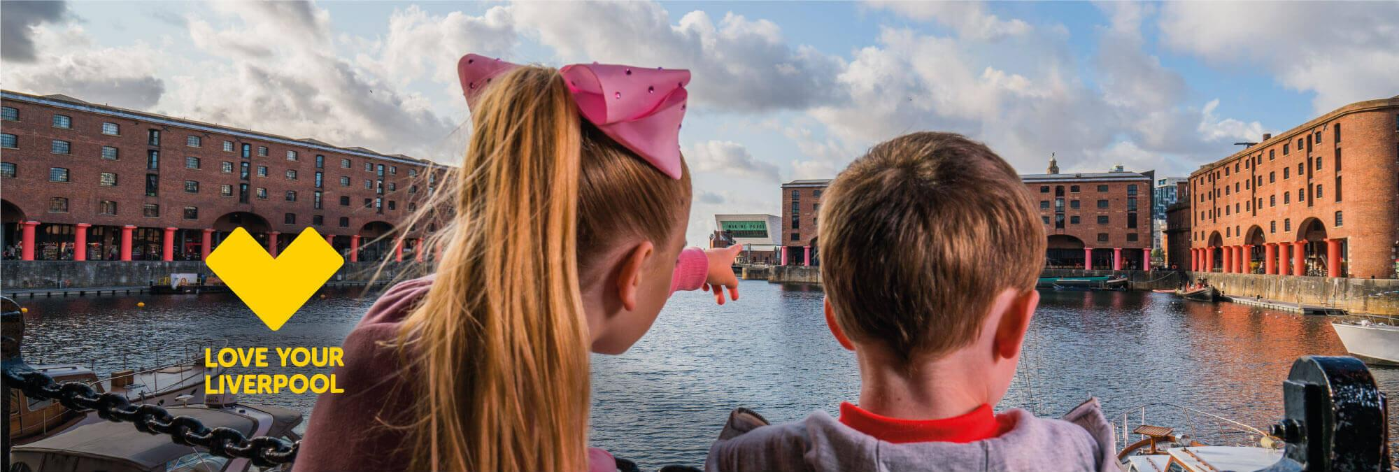 Two young children look out over the Royal ALbert Dock PAvillion