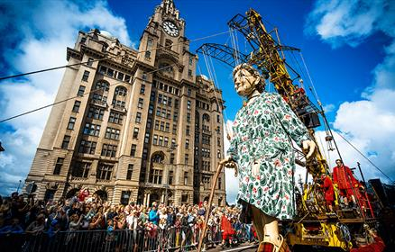 Grandma Giant in front of the Liver Building with crowds