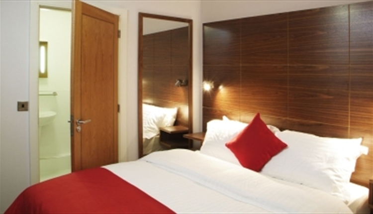 International Inn Cocoon Bedroom with king size beds and an en-suite bathroom.