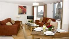 Fully furnished lounge at Liverpool's Premier Suites with modern facilities.