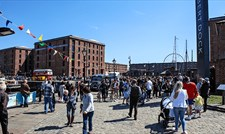 Families enjoying the Royal Albert Dock in the sunshine